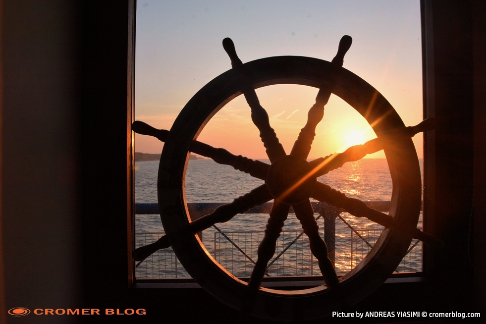 Sunset through a ships wheel Andreas Yiasimi